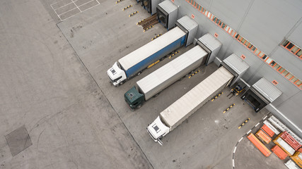 Trucks unloading in logostics center