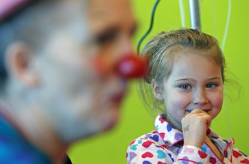 Girl looks at Belgian clown at the pediatric department of the Hopital Erasme at the ULB in Brussels