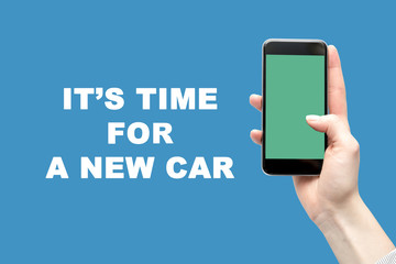 Smartphone in the woman's hand and the inscription is the time for a new car.