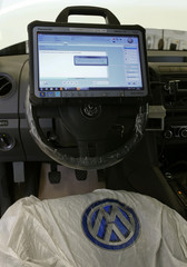 Volkswagen ODIS offboard diagnostic information system is mounted on the steering wheel of a diesel powered VW Amarok car at a garage of Swiss AMAG in Duebendorf