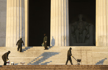 National Park Service workers spread salt on icy steps of the Lincoln Memorial in Washington