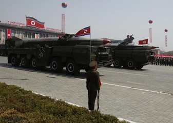 Rockets are carried by military vehicles during a military parade in Pyongyang