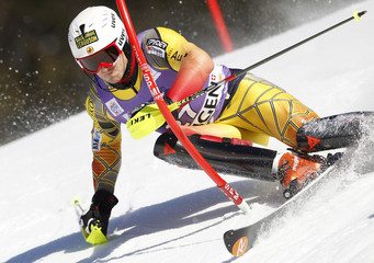 Canada's Spence clears a gate during the second run of the men's Alpine skiing World Cup slalom race in Wengen