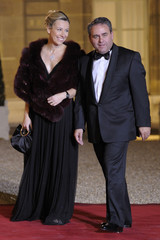 UMP leader Xavier Bertrand and his wife arrive at the Elysee to attend a state dinner in Paris