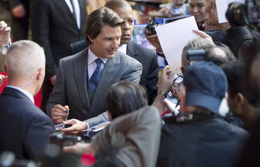 """U.S. actor Tom Cruise signs autographs at a British screening of the film """"Mission Impossible: Rogue Nation"""" in London, Britain"""