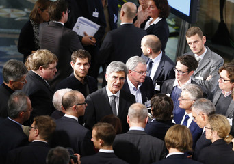 Germany's Siemens CEO Kaeser chats with journalists after annual news conference in Berlin