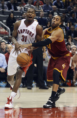 Toronto Raptors' Ross is fouled by Cleveland Cavaliers' Ellington during their NBA basketball game in Toronto