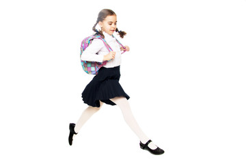A schoolgirl girl is jumping over obstacles.