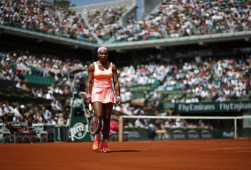 Serena Williams of the US reacts during her women's quarter-final match against Sara Errani of Italy during the French Open tennis tournament at the Roland Garros stadium in Paris