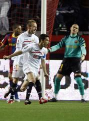 Sevilla's Navas celebrates his goal past Barcelona's goalkeeper Valdes during their Spanish first division soccer match in Seville