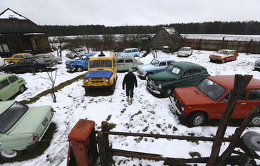 Collector Tsitovich, who finds and restores old cars and motorcycles, is seen at his base in Zabroddzie
