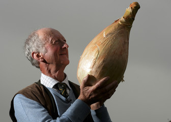 Glazebrook of Newark poses with his first prize giant onion during the first day at the Autumn flower show in Harrogate