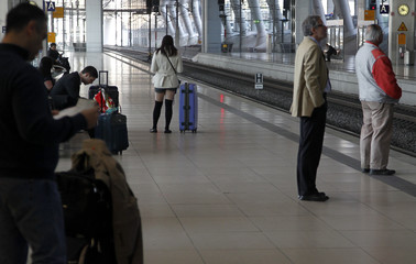 Passengers stand on a platform of the Air Rail Center at Frankfurt airport