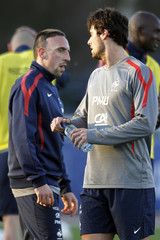 French soccer player Ribery looks at teammate Gourcuff during a training session in Clairefontaine