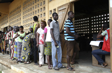 People line up to cast their ballots in Lome