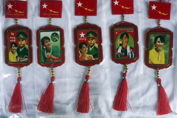 Car rearview mirror charms with pictures of Aung San Suu Kyi and her father, country's independence hero General Aung San, are photographed in a printing shop in Yangon
