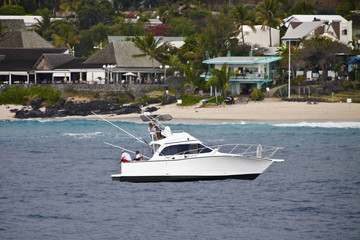 A file photo of a boat which fishes for sharks off the beach at Boucan Canot on the Indian Ocean island of Reunion