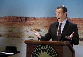 Cast member Cranston delivers remarks next to Heisenberg Hat from Breaking Bad at memorabilia donation at the Smithsonian Museum of American History in Washington