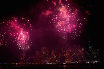 Macy's Fourth of July fireworks explode over the East River in New York