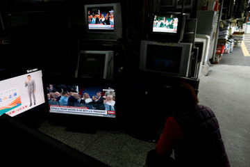 Images of U.S. President Donald Trump are seen on TV screens at a second hand shop in Taipei,Taiwan