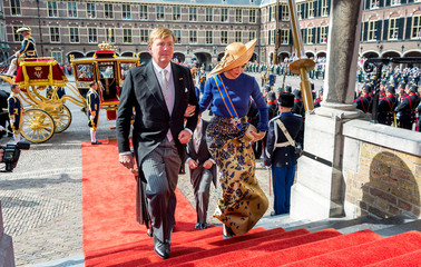 King Willem-Alexander of the Netherlands and his wife Queen Maxima arrive at the Hall of Knights in the Hague