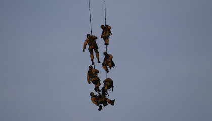 Members of Poland's Anti Terrorist Police Unit (BOA) are hoisted from a ship in Northern Poland