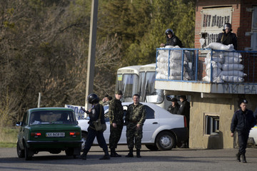 Ukranian troops stand guard at a checkpoint near the city of Izium in the Kharkiv region of east Ukraine