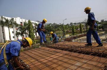Students are pictured at an outdoor classroom at the Larsen & Toubro construction skills training institute in Panvel