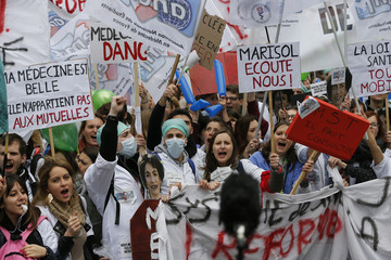 French doctors, medical students, and hospital interns and doctors attend a national demonstration to protest a new healthcare bill in Paris