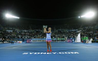 Svetlana Kuznetsova of Russia holds her trophy aloft after winning the Sydney International tennis women's singles title in Sydney