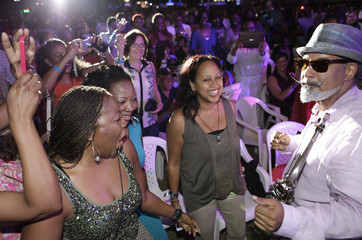 Saxophonist Arturo Tappin approaches fans as he performs during the Jamaica Jazz and Blues 2013 festival in Trelawny