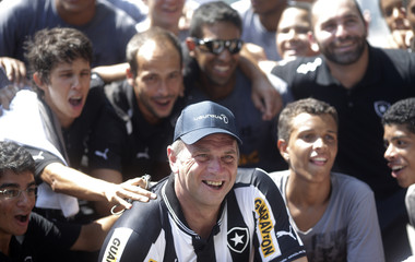 Britain's five-time Olympic rowing gold medallist Steve Redgrave wears a Botafogo's jersey after attending a rowing practice with athletes of Botafogo club ahead the Laureus World Sports academy awards in Rio de Janeiro