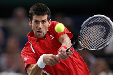 Djokovic of Serbia returns the ball to Querrey of the U.S. during the Paris Masters tennis tournament in Paris