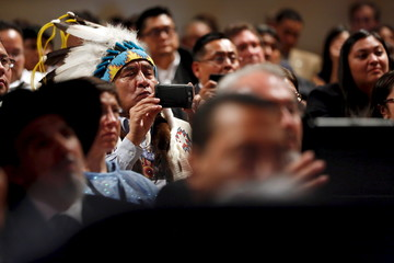 Attendees take pictures and video as Obama participates in the annual White House Tribal Nations Conference in Washington