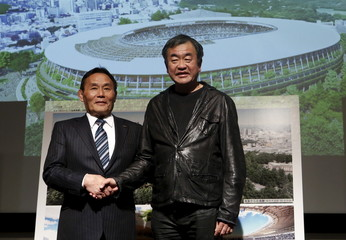 Ohigashi, President of Japan Sports Council, and Kuma , an architect and the designer of a New National Stadium, pose for pictures during a news conference in Tokyo