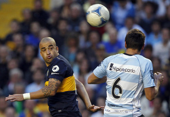 Boca Juniors' Silva and Racing Club's Cahais fight for the ball during their Argentine First Division soccer match in Buenos Aires