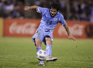 Uruguay's Nicolas Lodeiro scores during their international friendly soccer match against Estonia in Rivera