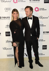 Aaron Paul and wife Lauren Parsekian arrive at the 2015 Elton John AIDS Foundation Oscar Party in West Hollywood