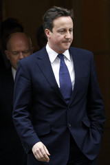 Britain's Prime Minister Cameron leaves Downing Street in central London