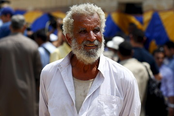An Egyptian man resembling Egyptian actor Omar Sharif is seen during Sharif's burial ceremony at El Shafie Cemetery in the old Islamic area of Cairo