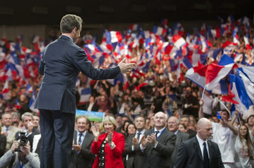 France's President  and UMP party candidate for the 2012 French presidential election, Nicolas Sarkozy, arrives on stage during a political rally in Nancy