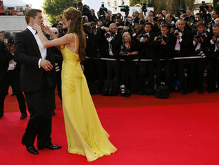 Brad Pitt and Angelina Jolie arrive for the world premiere of U.S. director Stephen Soderberg's film 'Ocean's 13' at the 60th Cannes Film Festival