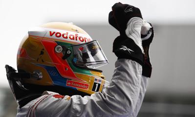 McLaren Formula One driver Hamilton of Britain celebrates winning the German F1 Grand Prix at the Nuerburgring circuit