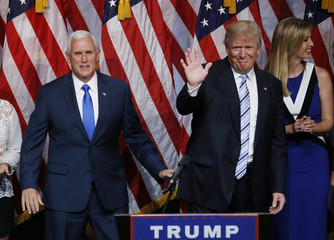 Republican U.S. presidential candidate Donald Trump waves as he departs after introducing Indiana Governor Mike Pence as his vice presidential running mate in New York