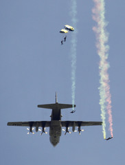 U.S. Navy SEALs of the Navy parachute team 'Leap Frogs' take part in a demonstration of combat skills as they jump from a U.S. Air Force C-130 aircraft in Fort Pierce