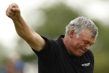 Clarke celebrates after winning the British Open golf championship at Royal St George's in Sandwich
