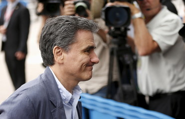 Newly appointed Greek Finance Minister Tsakalotos arrives at a euro zone finance ministers meeting in Brussels