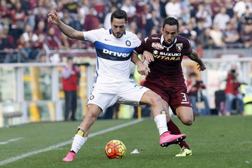 Inter Milan's D'Ambrosio and Torino's Molinaro fight for the ball during their Serie A soccer match in Turin
