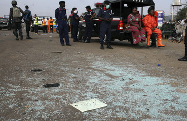 A piece of paper lies on the ground at the scene of a bomb blast explosion in Abuja