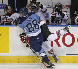 Quebec Remparts' Yanick Turcotte is checked by Rimouski Oceanic's Michael Joly during the first period of their Memorial Cup hockey game at the Colisee Pepsi in Quebec City